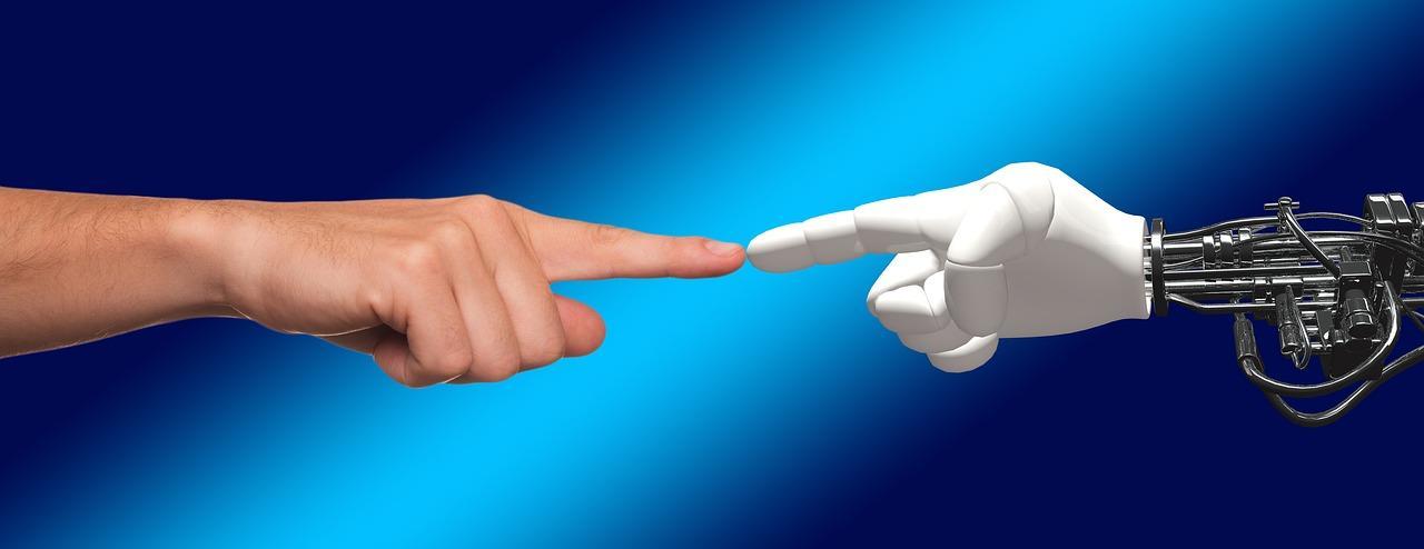 human hand touching a robot's hand